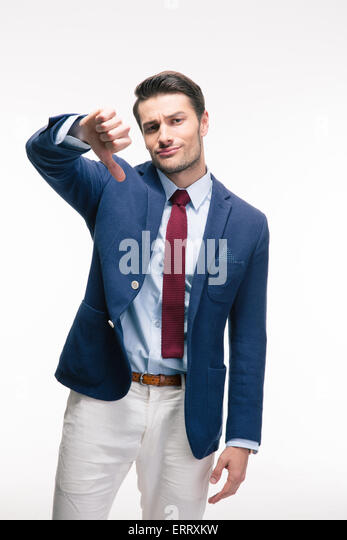 Businessman showing thumb down sign isolated on a white background. Looking at camera - Stock Image