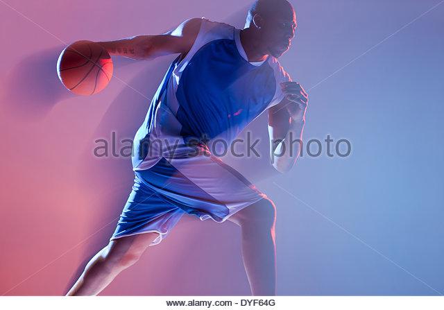 Blurred view of basketball player dribbling - Stock-Bilder
