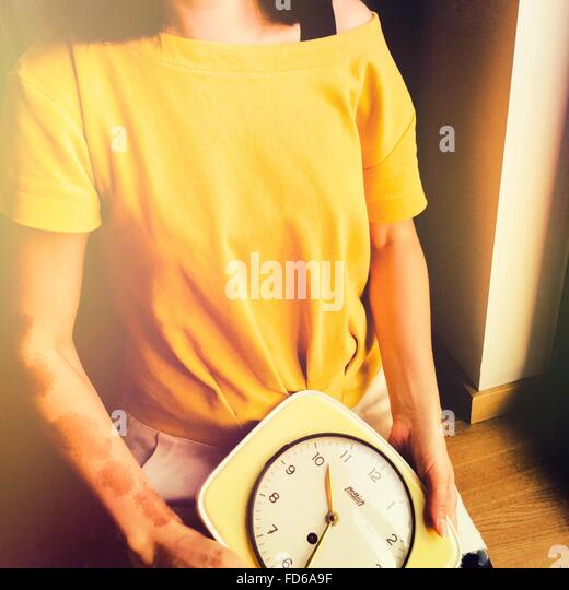 Woman Holding A Clock - Stock Image