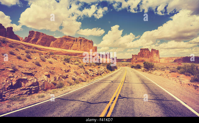 Vintage retro stylized scenic desert road, USA. - Stock Image