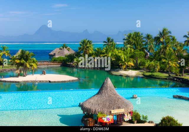 Pool at the Intercontinental Tahiti hotel with Moorea in background Tahiti. French Polynesia - Stock Image