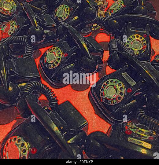 A colorful abstract digital artwork of many toy rotary telephones on a red surface - Stock Image