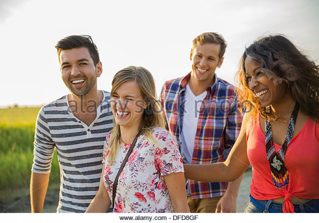 Group of friends laughing outdoors - Stock-Bilder