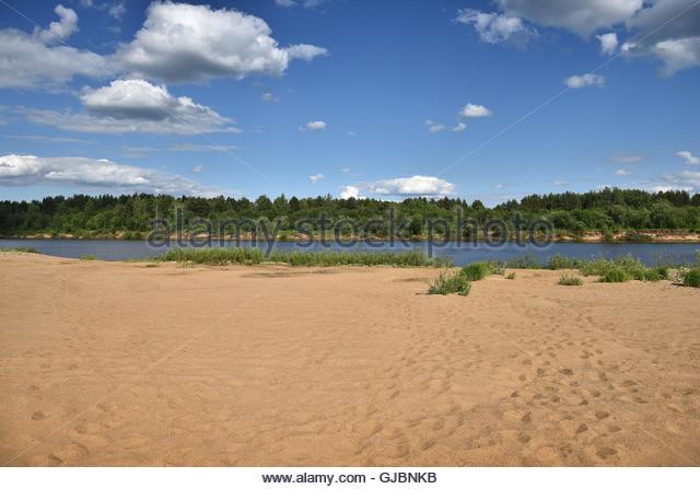 Warm sand on the banks of the river Vyatka. The beauty of Russian nature. - Stock Image