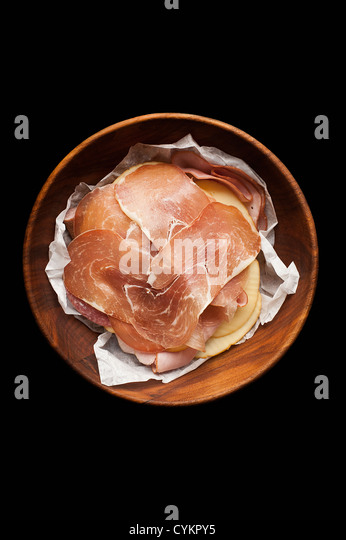 Plate of prosciutto ham and cheese - Stock Image
