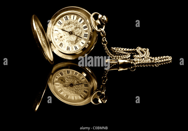 old pocket watch on black background with reflection - Stock Image