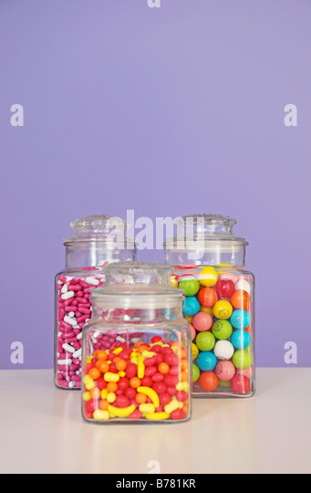 candy jars candy store good n plenty runts gumballs colorful sweets treats cavities jar three vertical image choice - Stock Image