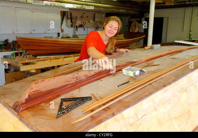 Massachusetts Cape Cod Hyannis Cape Cod Maritime Museum woman boat building class - Stock Image