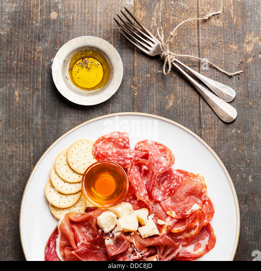 Platter of Assorted Snack ham, salami, cheese and honey - Stock Image