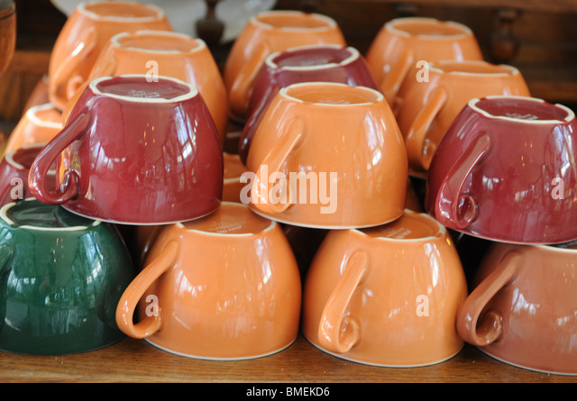 Pile of upside down coffee cups - Stock Image