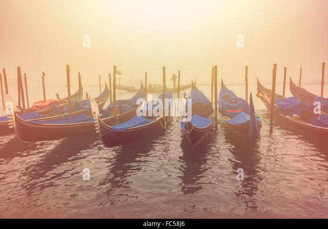 Venetian gondolas and canals on a hazy day - Stock Image