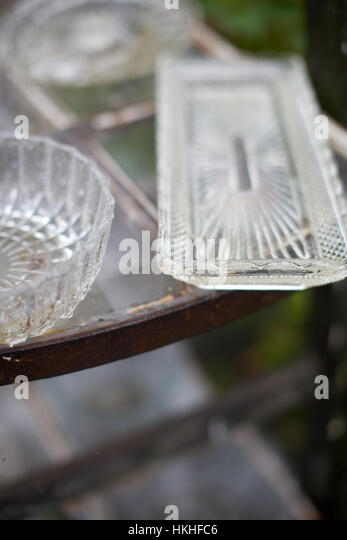 glassware for sale at flea market. table, crockery, second hand, sale. - Stock Image