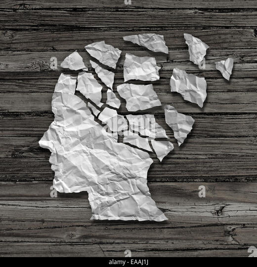 Alzheimer patient medical mental health care concept as a sheet of torn crumpled white paper shaped as a side profile - Stock Image