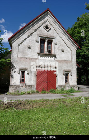 Audru Manor barn. Medieval window pillar are seen. Audru, Pärnu county, Estonia - Stock Image
