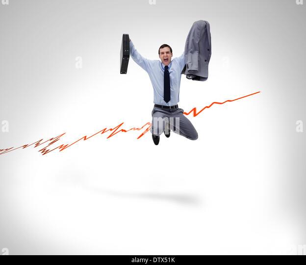 Joyful businessman jumping in the air - Stock Image