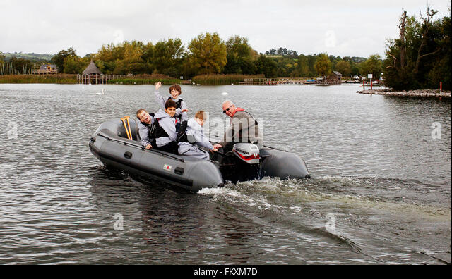 Children from Monnmouth School on the Llangorse lake - Stock Image