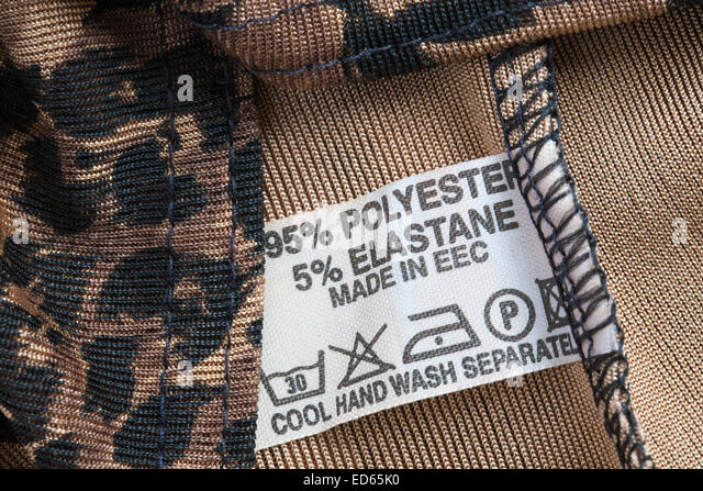 65% polyester 5% elastane made in EEC label in garment - Stock Image