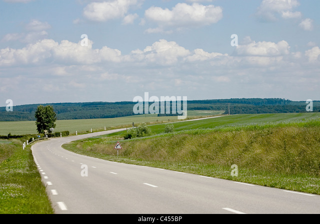 France, Giverny, Dieppe, Empty road through landscape - Stock Image