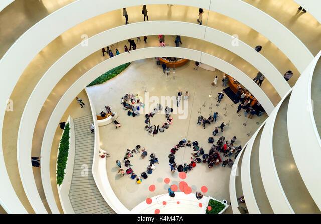 Interior of Solomon R Guggenheim Museum with schoolchildren, Manhattan, New York, USA - Stock Image