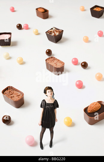 Small woman and big candy - Stock Image