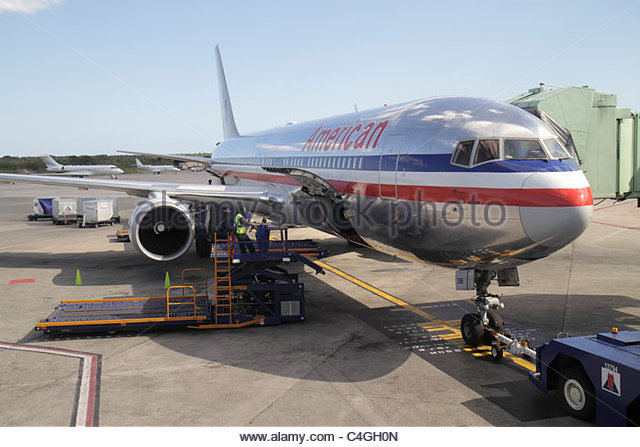 Dominican Republic Santo Domingo Las Américas International Airport SDQ aviation American Airlines jet gate - Stock Image