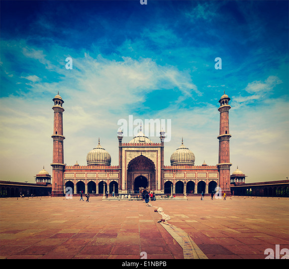 Vintage retro hipster style travel image of Jama Masjid - largest muslim mosque in India. Delhi, India - Stock Image