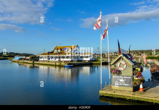 West Bay, Dorset, UK. 6th Oct, 2016. UK Weather. Glorious late afternoon autumn sunshine bathes The Riverside Restaurant - Stock Image