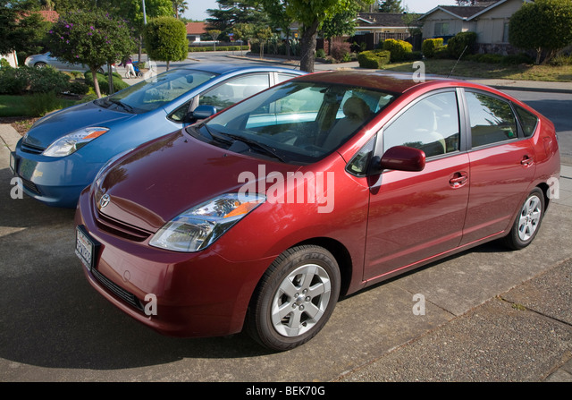 A side view of two parked Toyota Prius hybrid cars. Cupertino, California, USA - Stock Image