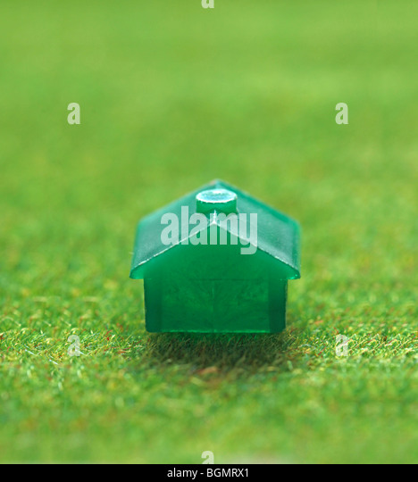 small green house on grass - Stock Image