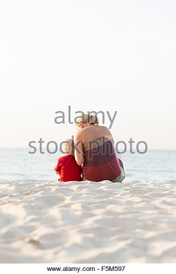 United Arab Emirates, Dubai, Mother with son (2-3) on beach - Stock Image