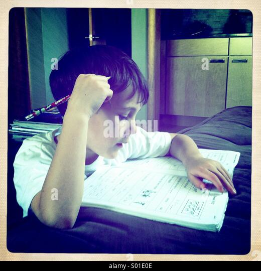 Boy doing his homework. - Stock Image