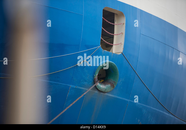 Rope coming from ship window - Stock Image