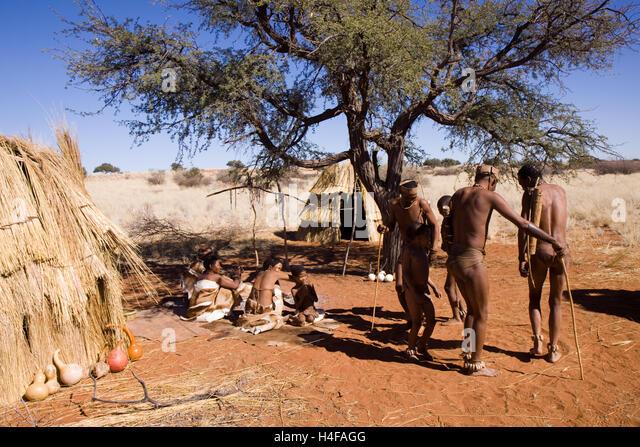 bushmen san dancind in their camp in central kalahari in namibia - Stock Image