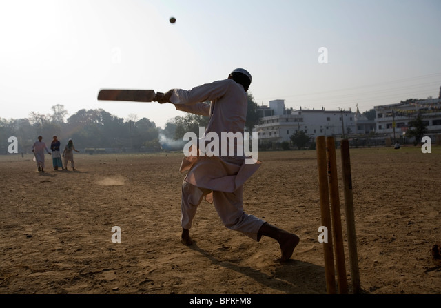 Muslim children playing cricket in open field Bodhgaya, Bihar, India. - Stock Image