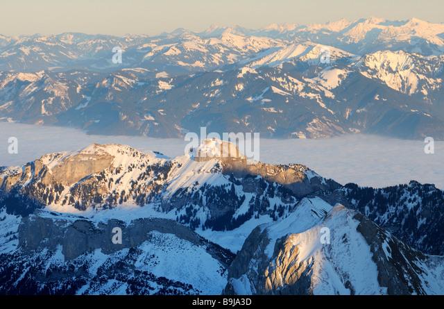 Mt Altmann and Mt Hoher Kasten in last daylight, between them the foggy Rheintal Valley, Canton of Appenzell Innerrhoden, - Stock Image