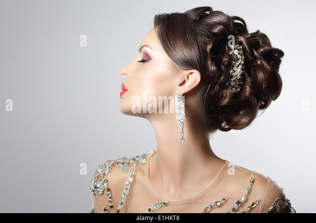 Fashionable Brunette with Costume Jewelry - Trendy Rhinestones and Strass - Stock Image