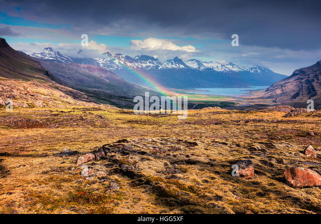 Light rain and the rainbow in the Icelandic mountains. Colorful summer morning in the Iceland, Europe. - Stock Image