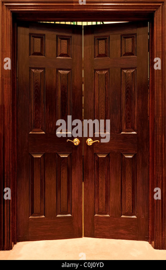 Wood Office Door With Brass Door Handle - Stock Image