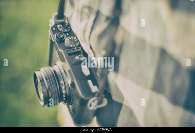 Man with an old camera - Stock Image