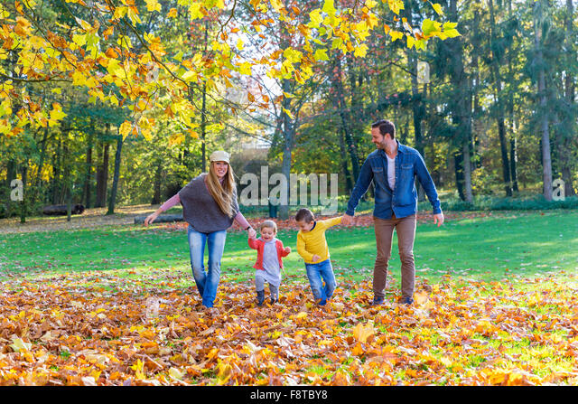 Family walking in park - Stock Image