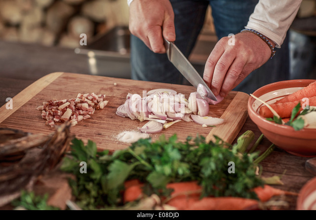 Person cutting onions - Stock Image