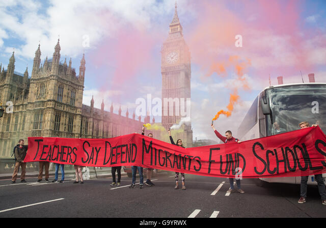 London, UK. 5th July, 2016. Striking teachers use a banner to block Westminster bridge in protest against racist - Stock Image
