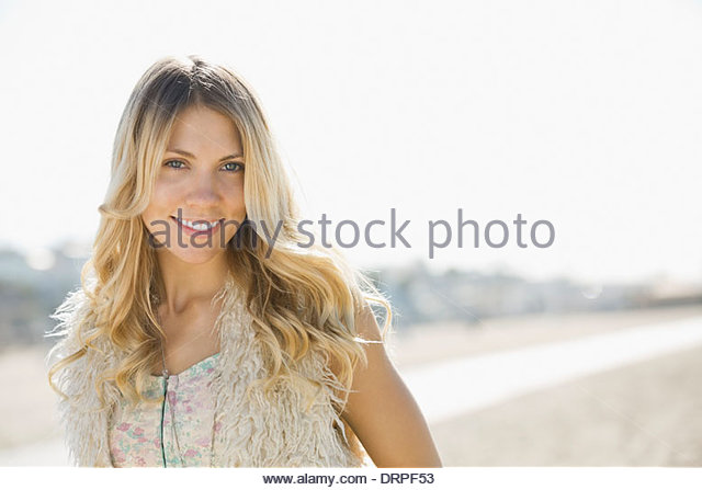 Portrait of woman standing on beach - Stock Image