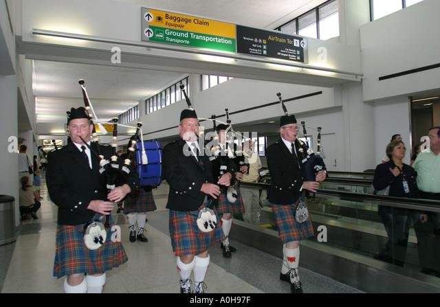 New Jersey Newark Liberty Airport Scottish bagpipes celebrate new service - Stock Image