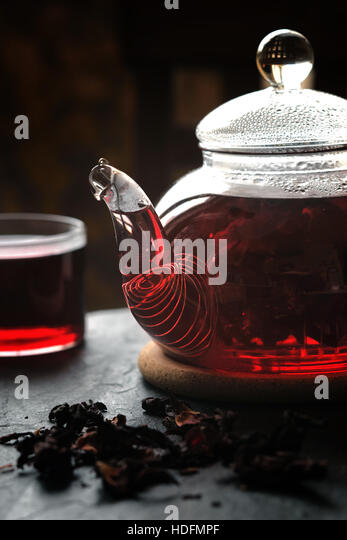 Tea in the glass teapot on the stone table vertical - Stock Image