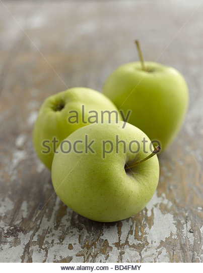Three Golden Delicious apples - Stock Image