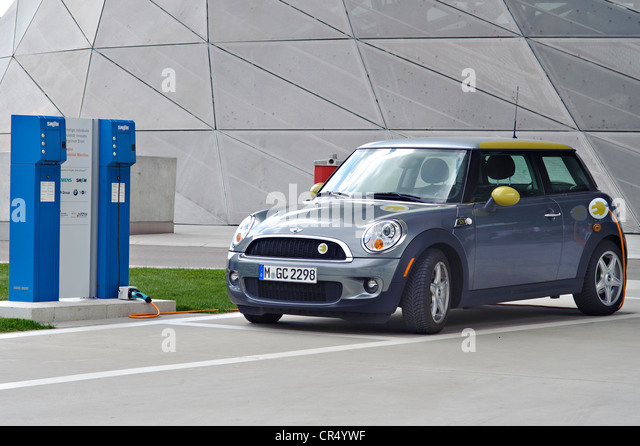 Charging up an electric car at a charging station, Munich, Bavaria, Germany, Europe - Stock Image