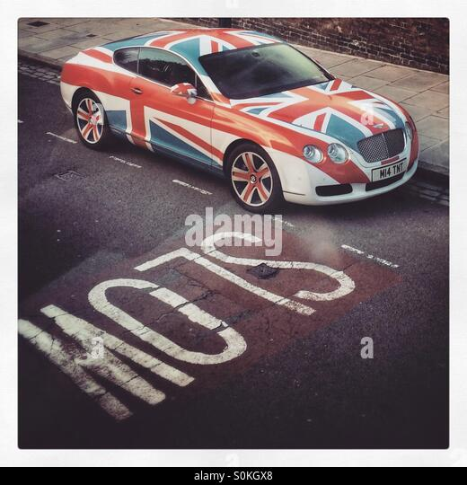 A Bentley car with Union Jack covered paintwork. - Stock Image