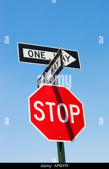 Stop sign and one way signs - Stock Image