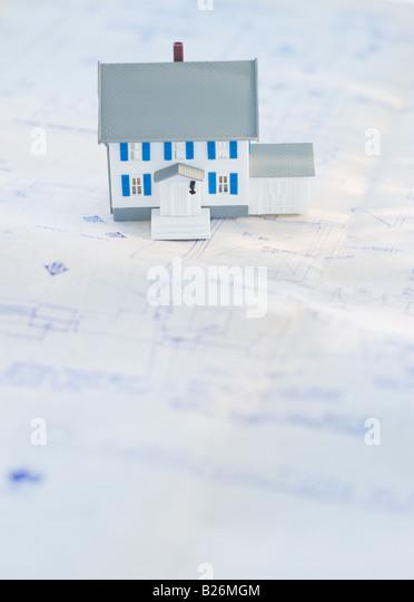 Model house on blueprints - Stock Image